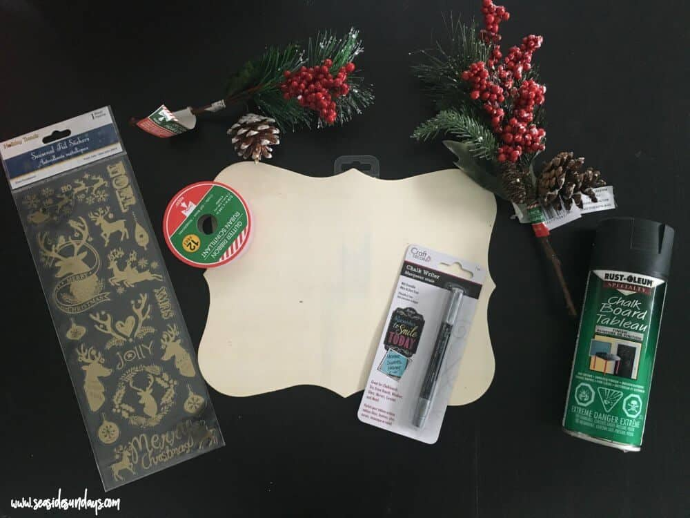 Chalkboard sign tutorial - how to make your own chalkboard sign using dollar store materials. These signs are cute for the holidays or as home decor all year long. You can make this sign in less than 30 minutes. Great for Christmas or fall decor.