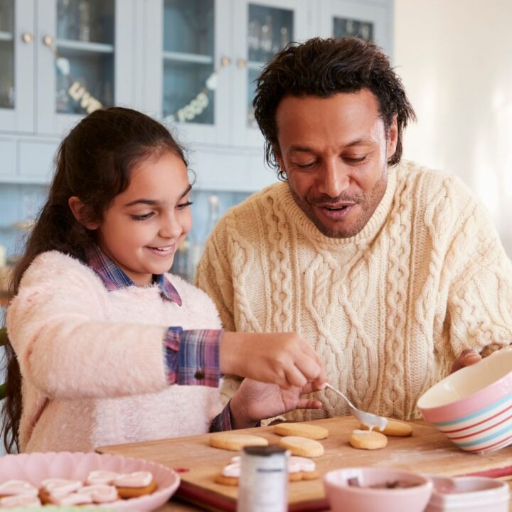 father daughter date cookie decorating together