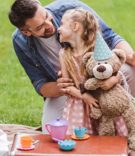 Teddy bear's picnic for father and daughter